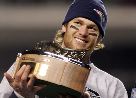 Patriots quarterback Tom Brady took a turn holding the AFC title trophy. He's now 8-0 in the playoffs.