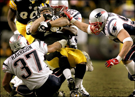 Rodney Harrison, Eugene Wilson, and Mike Vrabel (right) made life miserable for Steelers running back Duce Staley.