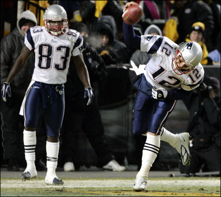 Deion Branch (83), who scored twice, and Tom Brady (two TD passes) had a lot to celebrate.