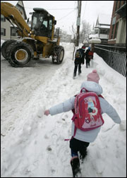 A student made her way to the Clap School in Dorchester yesterday.
