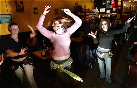 Belly dancers (from left) Mitara Koyla, Kimberly Mangino, and Seyyide Sultan at a meetup in the Middle East Restaurant.