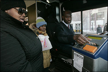 As Shameca Tyson (L) boarded an MBTA bus at Dudley Station yesterday with her 9-year-old daughter, Tyquannya, driver Ernus Vertus handed her an automated payment ticket.