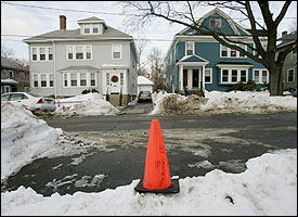 In Jamaica Plain, a traffic cone was placed next to a shoveled-out parking space on Castleton Street.
