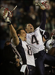 Patriots tight end Christian Fauria hoisted kicker Adam Vinatieri as the clock ran out last night.