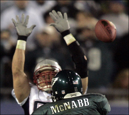 Donovan McNabb had Tedy Bruschi (7 tackles, 1 interception) and the Patriots defense in his face all night.