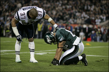 Patriots Rodney Harrison (37) reaches down to check on Philadelphia Eagles L.J. Smith, following their collision in the second quarter Sunday.