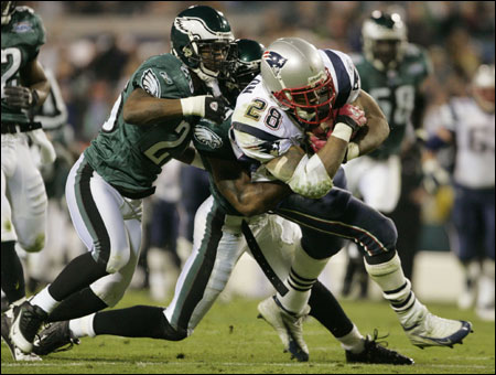 Finally in a Super Bowl, Corey Dillon holds nothing back, with the Eagles' Lito Sheppard and Brian Dawkins in tow.