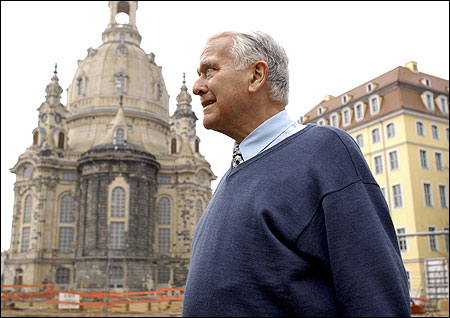 A Lutheran pastor, Karl-Ludwig Hoch, stood outside Frauenkirche Cathedral, which he will help to reopen today.