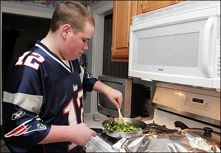 Bobby Bilodeau of Tyngsborough helped cook broccoli for dinner last week.