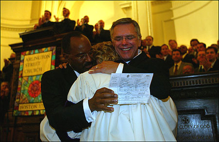 David Wilson (left) and Robert Compton and the Rev. Kim Crawford Harvie after she signed their Certificate of Marriage.