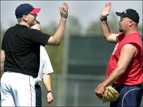 Ace Curt Schilling (left) and left-hander David Wells (right) high-fived each other after finishing the session.