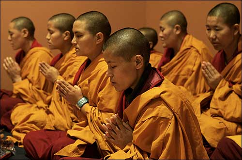 Tibetan Buddhist nuns from the Keydong Thuk-Che-Cho-Ling Nunnery in Kathmandu, Nepal, prayed and chanted before beginning a sand mandala at Davis Museum, Wellesley College, yesterday. The nuns are the first women ever trained in the ancient art.