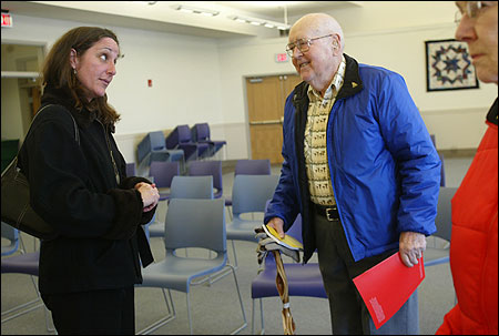 Michele Ellicks, Registry of Motor Vehicles elderly outreach coordinator, spoke with John Holt, 85, at the Concord Council on Aging Friday.
