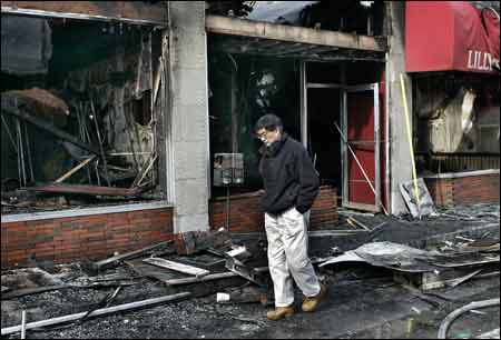 ''Henry'' Xiong Hu walked past the gutted shops yesterday. Among them was Ancient Moon, a jewelry shop where he worked for his sister.