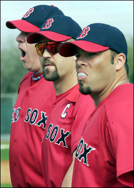 Captain Jason Varitek (center) wore the 'C' on his uniform for the first time Saturday, but yawning Curt Schilling (left) and bubble gum-blowing catcher Shawn Wooten (right) don't seem to think of it as anything out of the ordinary.