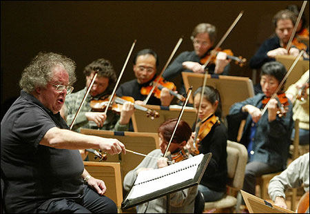 James Levine, shown rehearsing with the Boston Symphony Orchestra last week, has agreed to adjustments in programs.