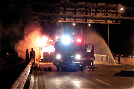 Firefighters battled a passenger bus blaze yesterday along the Mass. Pike eastbound in Newton.