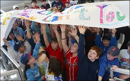 The Merriam School students held a banner that read 'If We Can Do it . . . Why Can't You.''