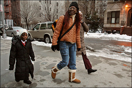 Aisha Tomlinson, center, walks with her daughter's Aleyah Joseph, left, and Alaysia Joseph after picking up Aleyah from the kindergarten afterschool program at Harlem Children's Zone Promise Academy Charter School in New York.
