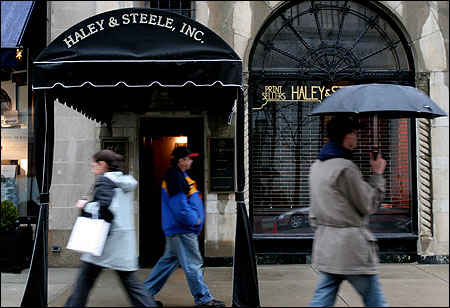 Pedestrians yesterday strolled past the Haley & Steele Inc. gallery, owned by Julien S. Tavener.