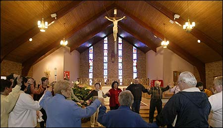 Parishioners of St. Anselm in Sudbury, after learning the church would reopen as a chapel.
