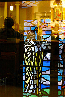 At the 4 p.m. Saturday Mass at Our Lady of Czestochowa Roman Catholic Polish church in South Boston, a stained-glass mural of the Pope is reflected on the inside door. An hour before the mass, Pope John Paul ll died, and the mass was dedicated to him as more than 100 parishoners, mostly Polish, came to worship.