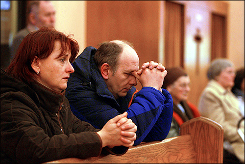 Ardlina Pilipiak and her friend Dariusz Paukouski prayed at the 4 p.m. Saturday Mass at Our Lady of Czestochowa Roman Catholic Polish church.