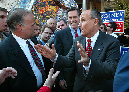 Angelo R. Buonopane (L), who will reimburse the state for eight days of missed work, appeared with former New York mayor Rudolph Giuliani and Governor Mitt Romney in 2002.