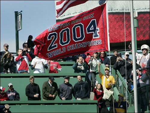 Fans on the Green Monster cheered as the 'Boston Red Sox 2004 World Champions' banner was raised in center field.