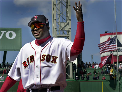 With the newly raised championship flag waving in the backround, David Ortiz showed off his new championship ring that he and his teammates had just received before the home opener against the Yankees.
