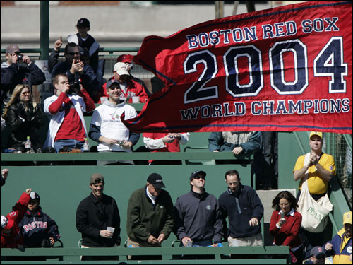 Fans on the Green Monster cheered and took pictures of the 2004 World Series championship flag after it was hoisted in center field.