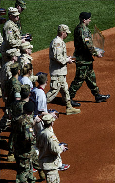 Members of the military, some of whom were patients at Walter Reed Army Hospital in Washington D.C., walked onto the field with the World Series rings that would be given out to members of the Boston Red Sox during the ring ceremony.