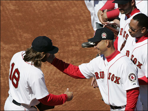 Johnny Damon got a pat on the cheek from Terry Francona after getting his ring.