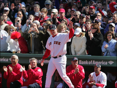Curt Schilling waved to the crowd after being introduced during the ring ceremony at the Red Sox' home opener against the Yankees.