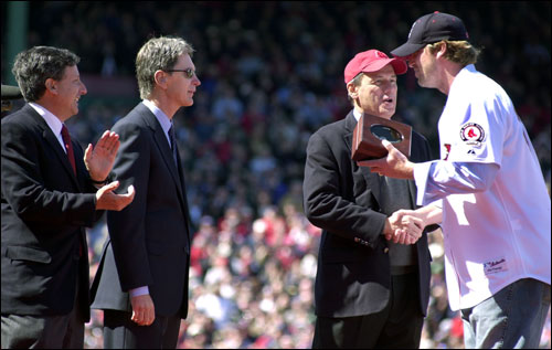 Red Sox executives (from left) Tom Werner, John Henry, and Larry Lucchino shook hands with former Red Sox pitcher Derek Lowe, who returned to receive his World Series ring during the pregame ceremonies.