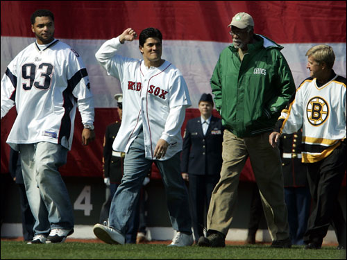 Left to right, Richard Seymour and Tedy Bruschi of the New England Patriots, and Boston sports legends Bill Russell of the Boston Celtics and Bobby Orr of the Boston Bruins walked in from the outfield together to take part in the ceremonial first pitch before the start of the Red Sox' home opener.