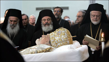 Archbishops (from left) Gregorios of England, Chrisodoulos of Greece, and Metropolitan Methodios of Boston flanked the body of Archbishop Iakovos, former head of the Greek Orthodox Church of the Americas, at his burial rites in Brookline yesterday.