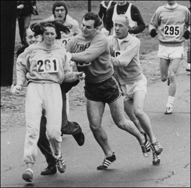 Mile 5: Pioneering woman In 1967, Kathrine Switzer, who registered as K.V. Switzer, was grabbed by race official Jock Semple (wearing dress shoes in photo), who attempted to tear off her number. When women were first allowed to enter in 1972, eight ran. Last year, the total was 7,708.