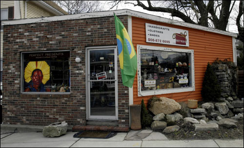 "Mile 5.9: Itty-bitty building Perfect Presents, 710 Waverly St. in Ashland, sells Brazilian arts and crafts in what, at 250 square feet, is likely the smallest store on the Marathon route. ""The Brazilians like our clothing, and the Americans like our crafts,"" says owner Nadja Oliveira."