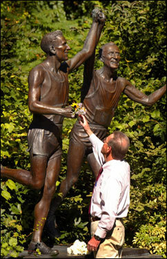 "Mile 19.2: Marathon hero Rich Muno's sculpture ''Young at Heart'' depicts Johnny Kelley crossing the finish line at age 27, when he won his first of two Boston Marathons, and at 84, when he ran his last Marathon. Kelley, who ran the Marathon 61 times, died last year at age 97. The statue is along Heartbreak Hill, a name said to have been coined in 1936 when Kelley ran neck and neck with Ellison ""Tarzan"" Brown. Kelley tapped Brown on the shoulder as he passed him. Brown then sped up, and Globe sports reporter Jerry Nason wrote that Brown regained the lead, ""breaking Kelley's heart."""