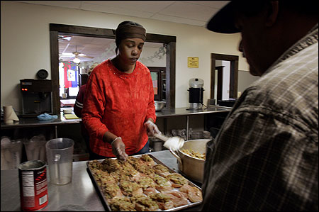 Winnie Thomas and a man named Luis prepared lunch last month at the Center House, a group for the mentally disabled near downtown Boston. The group faces cuts in United Way funding.