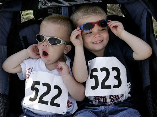 Eighteen-month-old Owen and 3-year-old Luke MacDonald of Hopkinton waited with varying degrees of patience for the race to begin.
