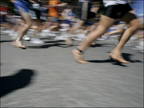 A pair of bare feet was spotted among the blur of passing runners in Hopkinton.