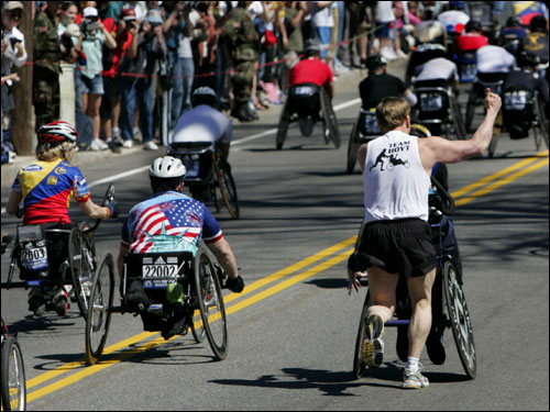 Dick Hoyt gave a thumbs up to the crowd as he ran yet another Boston Marathon with his wheelchair-bound son, Rick.