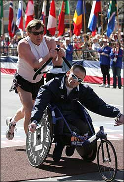 Richard 'Dick' Hoyt of Holland, Mass., pushed his son Rick across the finish line.