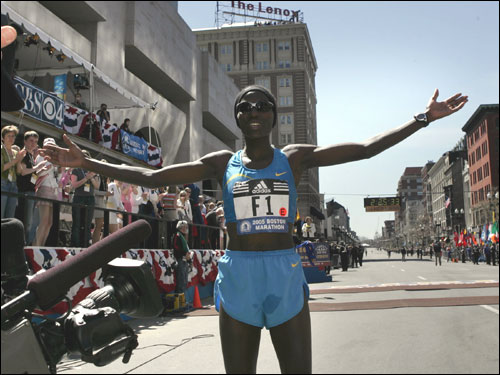 Catherine Ndereba takes it all in after making history with her fourth Boston Marathon title.