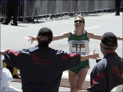 Bruna Genovese of Italy is elated at the warm welcome as she crosses the finish line for third place.