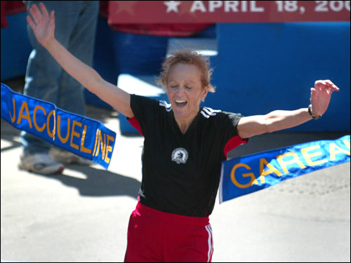 Canadian Jacqueline Gareau crossed the finish line, breaking the ceremonial tape to honor her 1980 Boston Marathon win. Gareau was denied her chance to break the tape in 1980 because of the infamous Rosie Ruiz incident. Ruiz had snuck into the race and finished ahead of Gareau, but it wasn't until well after Gareau had finished the race that Ruiz was recognized as a fraud.