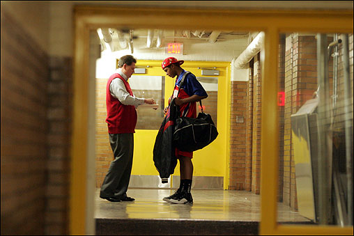 Coach Jack O'Brien confers with Charlestown senior Lamar ''Spot'' Brathwaite before an early-season game against Brighton. Spot has a sweet shot but struggles to maintain his confidence on the court.