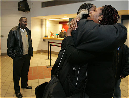 Co-captain Ridley Johnson gets a tearful hug from Emily Hunter-Coleman, his aunt and the adult he opens up to the most. At left is Stan Joplin, who will be Ridley's basketball coach at the University of Toledo next season.